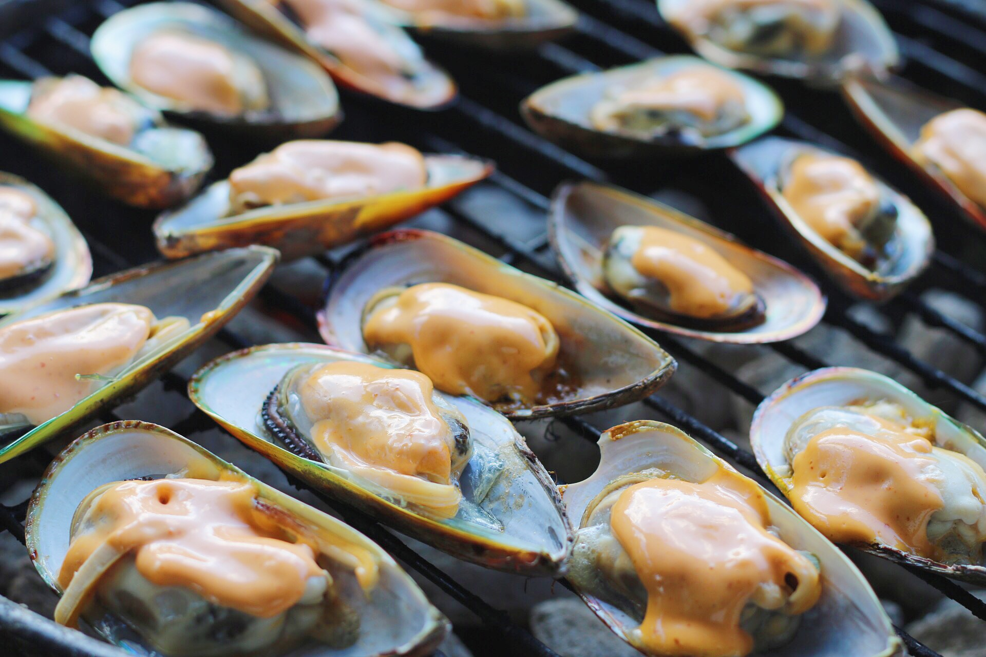 Grill your clean mussels for a few mins. Add Sriracha Mayo on top.