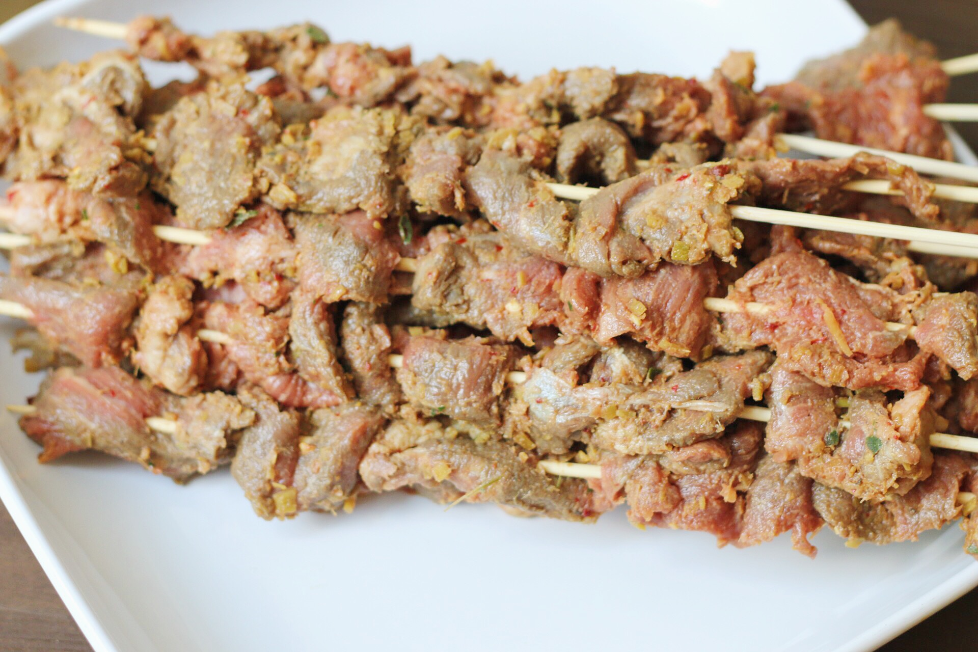 Skew a few pieces of meat on each stick. You want your meat to have enough space and be flatten so it can grill evenly.